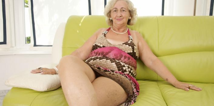 Mature.nl- Horny curly mature woman enjoys her wet pussy on the sofa